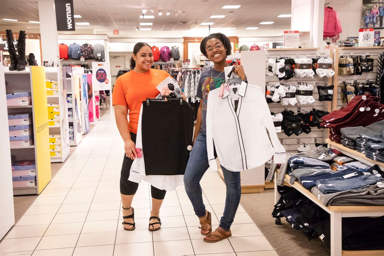 two young ladies showing outfits from JCPenny